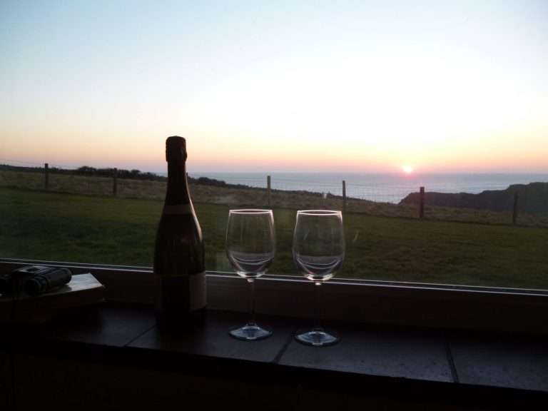 A view of the sunset from the sitting room at Clovercliff holiday cottage