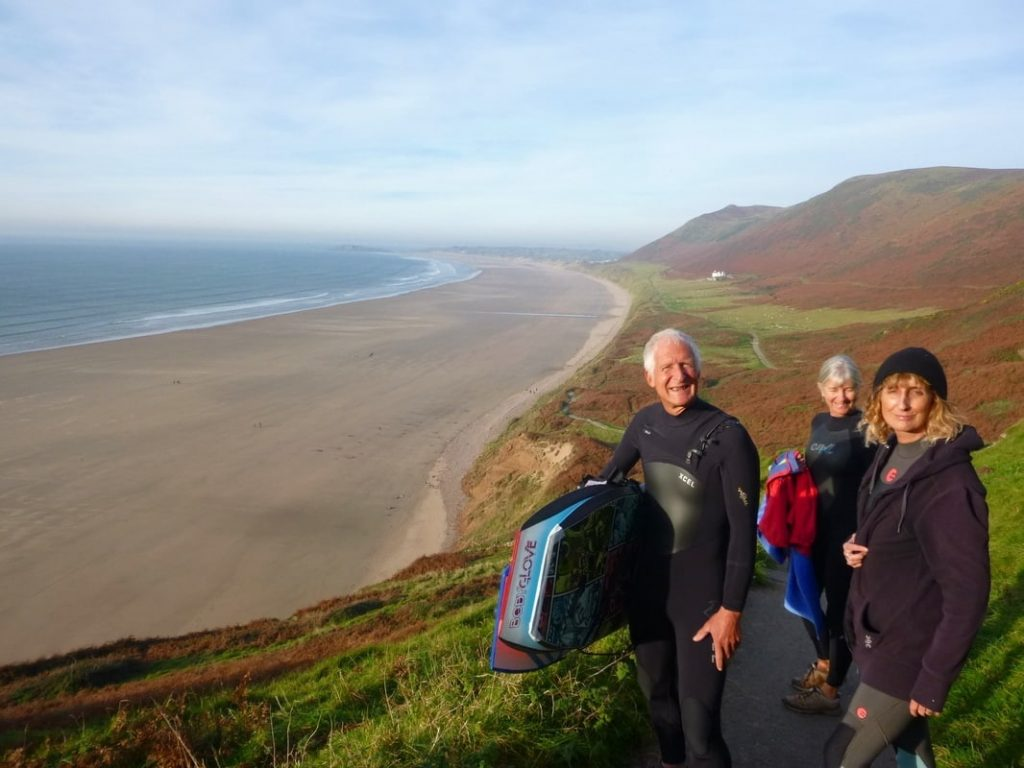 Going surfing at Rhossili bay